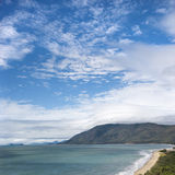 Queensland scenic coast. Scenic coastal view from Queensland Rex Lookout with mountains in background under blue sky with clouds royalty free stock photography