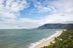 Queensland scenic coast. Scenic coastal view from Queensland Rex Lookout with mountains in background under blue sky with clouds royalty free stock photos