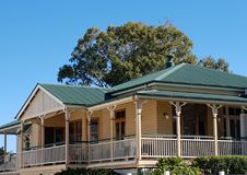 Queenslander in cream and green. Cream and green Queenslander on Autumn day, tin roof Royalty Free Stock Images