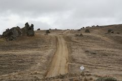 Queenstown Dirt Road. A dirt road near the saddle in Quernstown, New Royalty Free Stock Photo