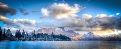 Queenstown Harbor, New Zealand. Queenstowns Lake Wakatipu carves into The Remarkables, a mountain range in the Central Otago Region of the South Island of New Royalty Free Stock Image