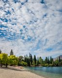 Beautiful morning at lake Wakatipu beach in Queenstown. Queenstown, New Zealand -December 23, 2017: Beautiful morning at lake Wakatipu beach in Queenstown, with Stock Photos