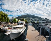 Boats at Queenstown Marina, New Zealand. Queenstown, New Zealand - December 23, 2017: Beautiful morning at Queenstown Bay Marina, Southern Island, New Zealand Royalty Free Stock Photo