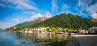 View of the alpine city of Queenstown, NZ. Queenstown, New Zealand -December 23, 2017: View of the alpine city of Queenstown in New Zealand, from the marina bay Stock Photo