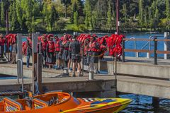 QUEENSTOWN, NEW ZEALAND - OCTOBER 10, 2018: A group of tourists in vests at the pier stock photo