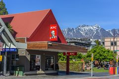 QUEENSTOWN, NEW ZEALAND - OCTOBER 10, 2018: Restaurant KFC on the background of the mountain landscape. Copy space for text stock photo