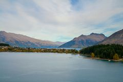 Queenstown New Zealand scenic view lookout with houses on lake Wakatipu stock photography