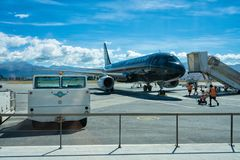 Queenstown Nya Zeeland - Januari 19, Air New Zealand svart bor arkivfoto