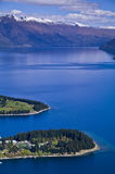 Queenstown NZ New Zealand. Beautiful Queenstown in NZ, in spring, snow still on the mountains stock photo