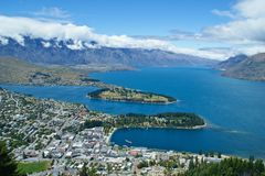 Queenstown and the Remarkables mountain range. With long white cloud, taken from above. New Zealand South Island Royalty Free Stock Images