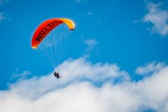 Tandem Paragliding in Queenstown, NZ. Queenstown Skyline, New Zealand -December 23,2017: A parachute against the blue sky with people having fun practicing Stock Photography