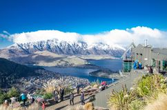 The top of the gondola with clouds on top of snowy mountain and lake view. Royalty Free Stock Photo