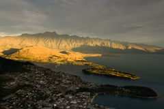 Queenstown Sunset. Queenstown from above with lake Wakatipu and sunset across remarkables mountain range Stock Photo