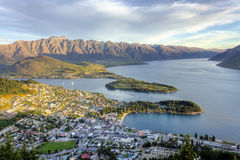 Queenstown Sunset. Light at sunset striking the Remarkables mountain range in Queenstown New Zealand Stock Photo