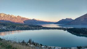 Queenstown Sunset with Houses and Mountains Royalty Free Stock Images