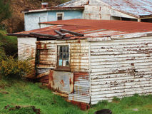 Queenstown Tasmania. Old run down weatherboard houses in the mining town of Queenstown on the west coast of Tasmania stock photo