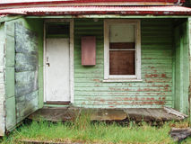 Queenstown Tasmania. Old run down weatherboard houses in the mining town of Queenstown on the west coast of Tasmania stock image
