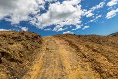 Gravel road Tasmania. Gravel mountain road: Queenstown in Tasmania, Australia Royalty Free Stock Photo