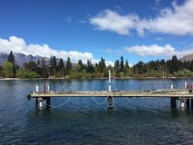 Queenstown Waterfront turquoise crystal clear water on sunny day Royalty Free Stock Image