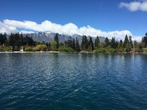 Queenstown Waterfront turquoise crystal clear water on sunny day Stock Photography