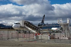 QUEENTOWN NEW ZEALAND - SEP6,2015 : air new zealand plane preparing for departure from queenstown airport in south island stock images