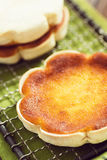 Queijadinhas or Queijadas on a Cooling Rack Royalty Free Stock Photo