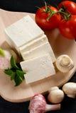 Queijo branco com vegetais Fotos de Stock