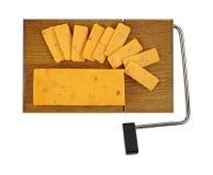 Queijo do salame do queijo Cheddar na placa de corte Imagem de Stock Royalty Free
