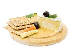 Queijo e biscoitos do brie Foto de Stock