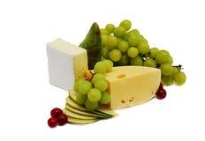 Queijo e frutas Imagens de Stock
