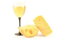 Queijo e um vidro com vinho Fotografia de Stock Royalty Free