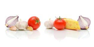Queijo e vegetais em um fundo branco Imagens de Stock Royalty Free