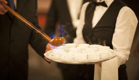 Queimada burning hot alcohol drink waiter in wedding Royalty Free Stock Images