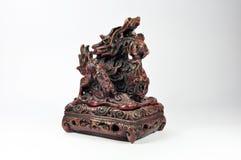 Queimador de incenso do dragão em um fundo branco Foto de Stock