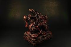 Queimador de incenso do dragão em um fundo preto Fotos de Stock Royalty Free