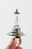 Queime a lâmpada H7 do farol do carro Fotografia de Stock Royalty Free