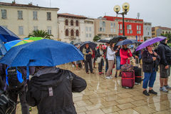 Queing in the rain Royalty Free Stock Photo