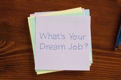 Quel ` s votre travail rêveur écrit sur une note Photographie stock libre de droits