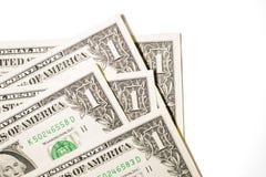 Quelques billets de banque des USA sur un fond blanc Images stock