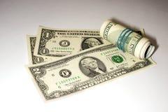 Quelques billets de banque des USA sur un fond blanc Image libre de droits