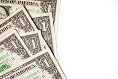 Quelques billets de banque des USA sur un fond blanc Photo stock