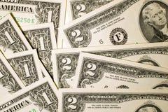 Quelques billets de banque des USA sur un fond blanc Photos libres de droits