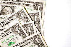 Quelques billets de banque des USA sur un fond blanc Photographie stock libre de droits