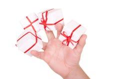 Quelques cadeaux dans la paume Image libre de droits