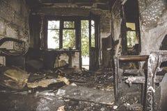 Quemado por el fuego y el sitio abandonado Imagen de archivo