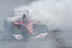 Quemadura de Ferrari F1 Imágenes de archivo libres de regalías