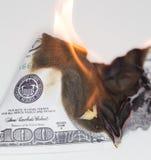 Quemadura de 100 USD Imágenes de archivo libres de regalías