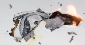 Quemadura de 100 USD Imagen de archivo libre de regalías