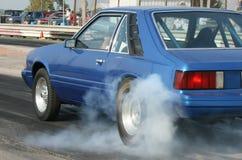 Quemadura del coche de la fricción del mustango Imagen de archivo libre de regalías