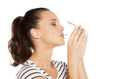 Quenching thirst. Young woman drinks water from a glass Stock Photos